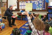 Naugatuck Assistant Superintendent of Schools Christopher Montini reads to kindergarten students at Salem Elementary School March 4 as part of a Read Across America Day celebration. –LUKE MARSHALL