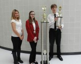 From left, Naugatuck residents and Kaynor Technical High School students Maria Contreras, Kelsi Weed and Jesse Roberts pose for a photo following the SkillsUSA State Championships. Several local Kaynor Tech students helped the school take top honors in SkillsUSA State Championships. Weed was part of three-member team that worked for seven months to document the chapter's activities in a nearly 200 page, artistic scrapbook. The team won. Prospect's Justin Fortin was part of a three-member team that won the Community Service team competition. The team prepared a notebook and a PowerPoint presentation describing the objectives and accomplishments of Kaynor's Feeding Children Everywhere Hunger Project. Fortin was also elected to be on the Connecticut SkillsUSA Executive Council for the 2016-17 school year. These two teams will compete at a national competition June 19 in Louisville, Ky. Against other state champions from across the country. Contreras earned a medal in an all-day cosmetology competition and Roberts came in second place with the other members of his Quiz Bowl team. -CONTRIBUTED