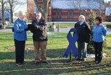 Naugatuck Mayoral Aide Ed Carter, second from left, presents a proclamation to Naugatuck Exchange Club President Claudia Vaudreuil in honor of the club's work to raise awareness of child abuse as, at right, Naugatuck Exchange Club member Bob Curina and former President Julie Fernandez look on April 5 on the Naugatuck Green. The Exchange Club also conducted a tree lighting ceremony for its 'Believe in the Blue' child abuse prevention project. April is National Child Abuse Prevention month. –LUKE MARSHALL