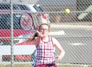 Naugatuck's Lori Dietz hits a shot during a doubles match with her partner, Patricia Escaleira, versus Woodland's Katie Rioux and Paige Gainey April 15 in Naugatuck. –ELIO GUGLIOTTI