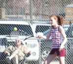 Naugatuck's Patricia Escaleira hits a shot during a doubles match with her partner, Lori Dietz, versus Woodland's Katie Rioux and Paige Gainey April 15 in Naugatuck. –ELIO GUGLIOTTI