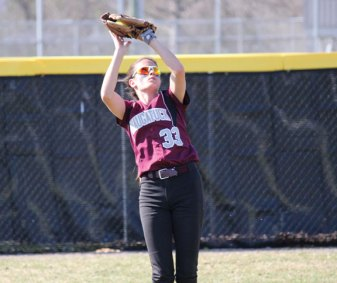 Naugatuck's Molly Kennedy catches a fly ball versus Holy Cross Monday in Naugatuck. Holy Cross won the game, 3-0. –ELIO GUGLIOTTI