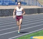 Naugatuck's Mark Zamani runs in the 800 April 19 during a quad-meet versus Crosby, Wolcott and Seymour in Seymour. Zamani won the event and two others at the meet. Through two meets, the Naugatuck boys and girls teams are 5-1. –KEN MORSE