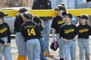 Members of the Union City Little League River Dogs relax before the start of the Little League's opening day ceremony April 16 in Naugatuck. –KEN MORSE