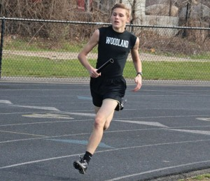 Woodland's Matthew Luxeder runs in the 4x800 relay April 12 during a quad-meet with St. Paul, Sacred Heart and Crosby in Beacon Falls. The Hawks have started the season 6-0. –LUKE MARSHALL