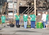 Volunteers from Comcast NBCUniversal helped clean up at the Naugatuck YMCA on April 30 as part of the 15th annual Comcast Cares Day. Volunteers cleaned, landscaped and painted at the YMCA. –CONTRIBUTED
