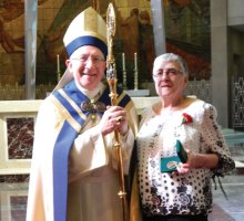 Beacon Falls resident Gloria Hollo, right, received The Archdiocese of Hartford Saint Joseph Medal of Appreciation during a ceremony April 17 at the Cathedral of Saint Joseph in Hartford. Hollo, a member of St. Michael's Church in Beacon Falls, is pictured with the Archbishop of Hartford, Rev. Leonard Blair. –CONTRIBUTED