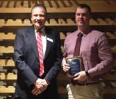 Ion Bank web developer Wayne Work, right, received the bank's 2015 SARF (Safety and Security, Accuracy, Responsiveness and Friendly, Personalized Service) Award. The award is given every quarter to the employee who best exemplifies the bank's service standards. From the quarterly group of recipients, an annual award recipient is chosen. Work, a Naugatuck resident, is pictured with President and CEO of Ion Bank Charles Boulier III. –CONTRIBUTED