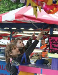 Ina Kerus and her son, Anthony Barabanov, 4, of Naugatuck, pick out a prize during the Coleman Brothers Carnival May 19 in Naugatuck. The carnival was sponsored by the Naugatuck Education Foundation, a nonprofit organization that provides grants for education programs in borough schools that aren't funded through the annual school budget. A portion of the proceeds from the carnival went to the NEF. –ELIO GUGLIOTTI