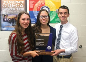 Naugatuck High School juniors Kelly Murphy, left, and Peter Morrissey, right, won third place in a recent international DECA competition. They are pictured with NHS DECA Chapter President Alexus Coney. –LUKE MARSHALL