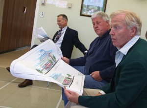 From left, Borough Attorney Ned Fitzpatrick, Deputy Mayor Robert Neth and Naugatuck Economic Development Corporation Treasurer Terry Barber look over architectural drawings for the proposed medical center on Parcel C during a meeting of the NEDC Monday night. –LUKE MARSHALL
