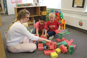 Naugatuck YMCA assistant preschool teacher Hailey Chamberlin helps William Perez, 4, left, and Liam Wallenta, 5, both of Naugatuck, build a castle made of blocks May 12 at the Y. The YMCA is in the midst of a capital campaign and has implemented improvements, including an additional preschool class. –LUKE MARSHALL