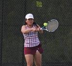 Naugatuck's Floraine Evardo returns a shot versus Watertown's Rachel Martineau May 20 during the Naugatuck Valley League tennis tournament final in Beacon Falls. Naugatuck won the match, 4-3. –ELIO GUGLIOTTI