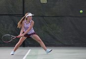 Naugatuck's Kelly Carr lines up a shot during her match versus Watertown's Mary Zaborowski May 20 during the Naugatuck Valley League tennis tournament final in Beacon Falls. Naugatuck won the match, 4-3. –ELIO GUGLIOTTI