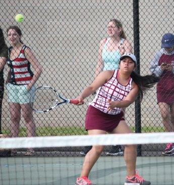 Naugatuck's Diana Velasco returns a shot versus Watertown's Elizabeth Rinaldi May 20 during the Naugatuck Valley League tennis tournament final in Beacon Falls. Naugatuck won the match, 4-3. –ELIO GUGLIOTTI