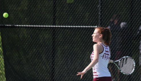 Naugatuck's Patricia Escaleira lines up a shot during a doubles match with her partner, Lori Dietz, versus Watertown's Christina Barkow and Alyssa Clifford May 20 during the Naugatuck Valley League tennis tournament final in Beacon Falls. Naugatuck won the match, 4-3. –ELIO GUGLIOTTI