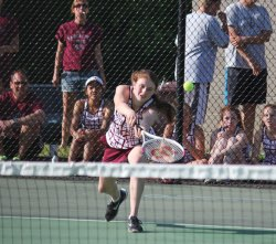 Naugatuck's Gina Greco lunges to return a shot during a doubles match with her partner, Nicole Bolduc, versus Watertown's Gabby Traver and Arieta Xhena May 20 during the Naugatuck Valley League tennis tournament final in Beacon Falls. Naugatuck won the match, 4-3. –ELIO GUGLIOTTI