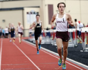 Naugatuck's Mark Zamani keeps his eye on the finish line during the 1600 at the NVL track and field championships in Torrington on Tuesday. Zamani won the event. –REPUBLICAN-AMERICAN