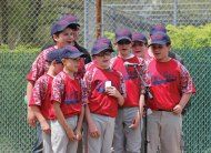 The Prospect Little League Red Sox recite the Little League pledge during the league's opening day ceremony May 14 in Prospect. The Little League is celebrating its 50th anniversary this year. –ELIO GUGLIOTTI