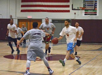 Former Naugatuck High School basketball player Anthony Mariano pushes the ball up the court April 30 during the 3rd annual Joshua E. Ruccio Scholarship Basketball Game at the high school. The game between the Old School All-Stars and the New School All-Stars brought out a good crowd of basketball fans for the benefit of this year's Naugatuck High graduates. The game is held in honor of Josh Ruccio, who died suddenly Jan. 16, 2012 at the age of 35. He played baseball and basketball at the high school and coached at every level of youth sports in the borough. New School All-Star head coach and event coordinator Jodie Burns announced that $6,000 was raised. The New School All-Stars won, 102-95. –KEN MORSE