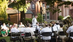 Conductor Joel Knecht, with the Naugatuck Community Band, leads the musicians Tuesday night at the Naugatuck Green. Musical performances will be held there every Tuesday night during the summer. This year is the 30th year the concerts, which are hosted by the Naugatuck Arts Council, have been held. -REPUBLICAN-AMERICAN