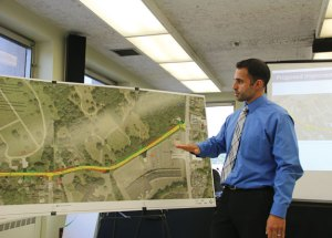 Milone & MacBroom Project Manager Paul DeStefano discusses the planned Cross Street reconstruction project during an informational public meeting June 24 at Naugatuck Town Hall. The project requires the state to buy two homes and pieces of several other properties on the street. –LUKE MARSHALL