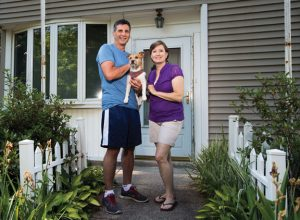 Frank and Anita Finkle, with their dog Rusty, stand for a photograph at their Cotton Hollow Road home in Naugatuck June 24. The borough is planning on widening Cross Street, a move that would include knocking down Finkle's home, another home and shaving pieces off other yards along Cross Street. –REPUBLICAN-AMERICAN
