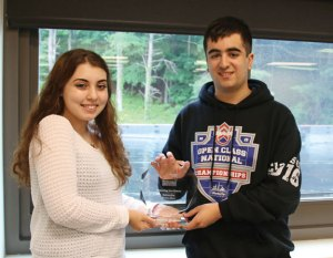 Naugatuck High School seniors and members of the school's Film Club Lauren Reilly, left, and Vincenzo Pavone hold the trophy the club won at the Connecticut Student Film Festival for the documentary 'Parades and Protests.' –LUKE MARSHALL