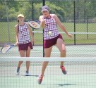 Naugatuck's Ally Mezzo hits the ball as her doubles partner, Kelly Murphy, looks on during their semifinal match in the NVL girls individual tennis tournament against Watertown's Rachel Martineau and Julia D'Occhio May 26 at Woodland in Beacon Falls. Martineau and D'Occhio won the match. –ELIO GUGLIOTTI