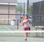 Naugatuck's Diana Velasco returns a shot during a doubles match with her partner, Floraine Evardo, against Watertown's Rachel Martineau and Julia D'Occhio in the Naugatuck Valley League girls individual tennis tournament final May 26 at Woodland in Beacon Falls. Watertown won the match, 6-1, 6-1. –ELIO GUGLIOTTI