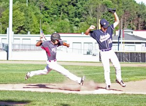 Post 17's Joshua Aviles hustles down the first-base line to try and beat out the throw as Bethel's Chaz Cywin gets the force out Tuesday night during the first game of a doubleheader at Naugatuck High School. –ELIO GUGLIOTTI