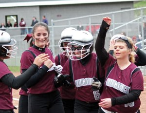Naugatuck senior Jackie Aronin (6), pictured after hitting a leadoff home run in the Greyhounds' first home game of the season, led the team with 35 hits. Aronin is one of six seniors that set the example for the younger players this year. –FILE PHOTO