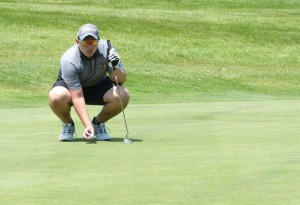 Woodland's Josh Hassan examines a green before a putt during the NVL championship June 2 at the Watertown Country Club. –REPUBLICAN-AMERICAN