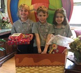 Students from St. Francis-St. Hedwig School in Naugatuck visited Beacon Brook Health Center during National Nursing Home Week in May and entertained residents with a concert. Pictured are the winners of a coloring contest judged by the residents. From left, Chloe Massicotte (first place), Daniel Reilly (second place) and Isabella Siqueira-Beard (third place). -CONTRIBUTED
