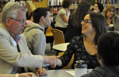 Prospect Mayor Robert Chatfield shakes hands with Woodland Regional High School student Bianca Poehailos during a breakfast to celebrate the first year of an internship program May 24 at the school in Beacon Falls. The breakfast brought together students and employers. The program, which was piloted during the 2015-16 school year, offers opportunities students for students to intern in a field they are interesting in pursuing as a career. -KATIE MINUTILLO/HAWK HEADLINES