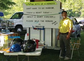 Daniel Whitman, of Naugatuck, raised money and distributed information to support Jane Doe No More, Safe Haven of Greater Waterbury and the St. Vincent DePaul Mission's homeless shelter recently during the Woodbury Lions Club's annual car show. –CONTRIBUTED