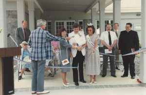 Prospect Mayor Robert Chatfield, center, cuts a ribbon during a ceremony on June 16, 1991 to officially open the Prospect Public Library building at 17 Center St. This year, the library is celebrating the 25th anniversary at its current location as well as the 130th anniversary of the library association in Prospect. –COURTESY OF THE PROSPECT PUBLIC LIBRARY