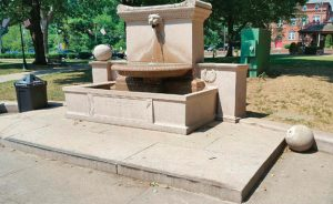 The ball on the left side of the historic fountain on the town Green in Naugatuck was found on the ground Monday morning. -CONTRIBUTED