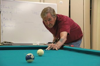 Edward Picanso, of Naugatuck, tries to put the 10 ball in the corner pocket recently during the Naugatuck Senior Center's U.S. Army Billiards Tournament. The competition featured members of the senior center and the U.S. Army Recruiting Station in Waterbury. Naugatuck resident and senior center member Robert Haney won the tournament and received a gold statue and a gift basket. –CONTRIBUTED