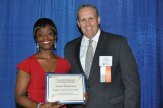 Naugatuck Valley Community College graduate Francine Muanda-Nzuzi, of Naugatuck, left, accepts the Connecticut Rising Junior Accounting Scholarship from CTCPA Educational Trust Fund trustee John J. Turgeon, at the organization's Recognition Reception held recently at the Aqua Turf Club in Plantsville. Muanda-Nzuzi plans to continue her education at a four-year college or university in the fall. –CONTRIBUTED