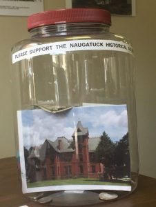 The Naugatuck Historical Society has placed clear plastic containers, called 'Jugseums,' in businesses throughout the borough as part of a contest and outreach program. –CONTRIBUTED