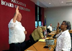 Naugatuck Mayor N. Warren 'Pete' Hess, left, swears in Ethel Grant Aug. 11 to fill a vacancy on the Board of Education. –CONTRIBUTED