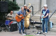 Ride, an American West-themed band, plays in front of the Whittemore Library in Naugatuck July 29 as part of the library's second annual Happy Hour. In addition to the music, the event featured drinks provided by Fine Wine and Liquors. –LUKE MARSHALL