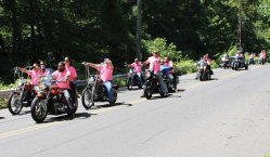 Motorcyclists make their way in Naugatuck on Aug. 7 during the 6th annual Motorcycle Benefit Ride to raise money for the Kacey Rose Foundation. The foundation raises money to help families with a child battling cancer and works to raise awareness of services available to families. The fundraiser is organized annually by Moe's Auto Service owner Moe Shira in honor of his niece, Kacey Rose Mitchell, who died from leukemia. Over 50 people, including 38 motorcyclists, participated this year. The ride raised about $2,400 for the foundation. –JORDAN E. GRICE