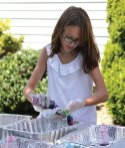 Elizabeth Pavlik, 10, of Prospect, tie-dyes a sock at the Prospect Library Aug. 19 during a town-wide picnic to celebrate the library's 130th anniversary. The celebration included games, crafts and light snacks for visitors. –ELIO GUGLIOTTI