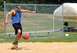 Kyle Menta, of team Booze on First, kicks the ball during the fourth annual Susie Classic kickball tournament Aug. 6 at the Pent Road Recreation Complex in Beacon Falls. The day-long event raised money for The Susie Foundation to help fund research and support ALS patients, families and caregivers in Connecticut. - JORDAN E. GRICE