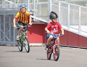 Naugatuck YMCA members Daniel Keogh, 8, of Beacon Falls, right, and Patrick Osiecki, 12, of Naugatuck, ride bicycles July 28 at Naugatuck High School as part of a six-week training program to get ready for the YMCA Race4Chase Triathlon. The triathlon, which is Aug. 6 at YMCA Camp Sloper in Southington, is funded by the Chase Michael Anthony Kowalski Foundation. The foundation was set up in memory of Kowalski, a young triathlete who was killed in the Sandy Hook Elementary School shooting in 2012. The triathlon is open to children ages 6 to 13 that are members of one of 14 YMCAs across the state. The triathlon will feature a 1.25 mile bike ride, a 1 mile run, and a 100 meter swim. –LUKE MARSHALL