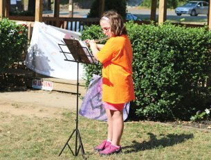 Cassondra Sanford, 11, of Naugatuck, plays the flute July 22 on the Naugatuck Green during the Naugatuck YMCA's Summer Camp Talent Show. –LUKE MARSHALL