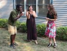 From left, Naugatuck Youth Services youth leaders, Ellis Sadler, 16, Amanda Valentin, 18, and youth board member Allison Tortorici, 18, share a laugh July 20 during the organization's Potluck BBQ celebration at the youth services building on Scott Street. –LUKE MARSHALL