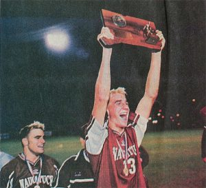 Then-Naugatuck High senior B.J. Kochis raises the Class LL state title plaque as then-senior Brian Mariano, left, looks on after Naugy beat Westhill, 3-2, in the title game in 2001. -NAUGATUCK DAILY NEWS